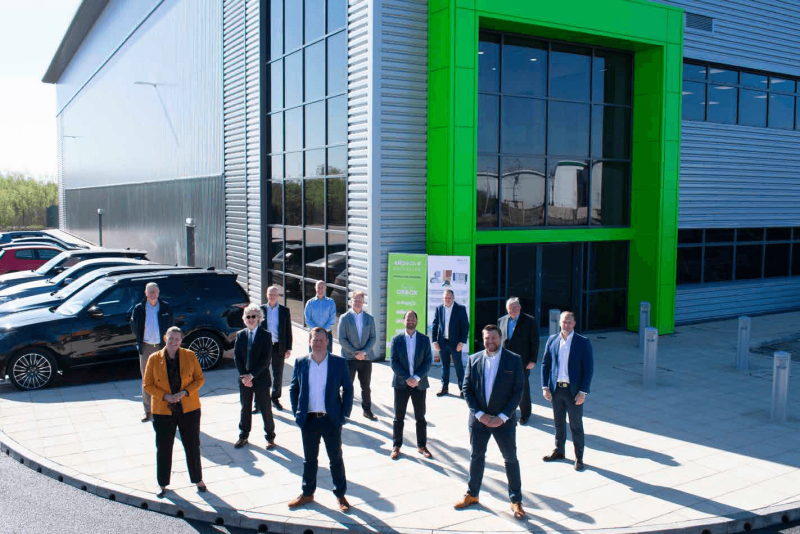 Barberry hands over Allpack's new headquarters at Kingswood Lakeside Business Park in Cannock. Front row, right to left; Jon Robinson (Barberry), Bob Clarke (Allpack), Louise Brooke-Smith (GBSLEP): 2nd row – right to left; Marcus Clarke (Allpack), Henry Bellfield (Barberry), Eric Henderson (Staffordshire County Council). 3rd Row – right to left; Jim Clarke (Allpack), George Clarke (Allpack), Richard James-Moore (JLL), Jon Mott (Barberry), Nick Oakley (FDC), Kevin Zamur (Benniman).