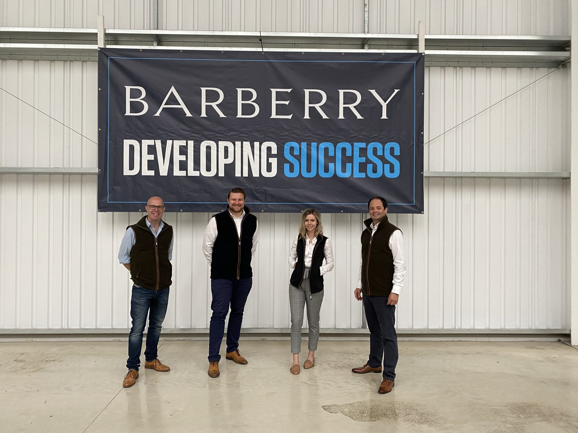 Pictured at the warehouse are (from left) Jonathan Mott, Jonathan Robinson, Emilie Douglas, and Henry Bellfield of Barberry.